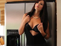 Sexy Natasha Belle shows some skin while mixing an alcoholic drink