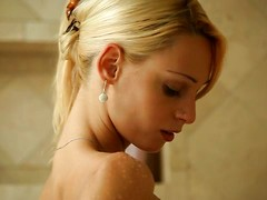 Come watch as beautiful blonde Erica Fontes uses the showerhead and her talented fingers to pleasure her hot pussy