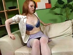 Outstanding redhead slowly removes sexy office outfit revealing cream tights and lace lingerie.