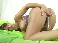 Sensual and sexy brunette fondles her big natural tits and peels off her panties to pummel her bald pussy with a vibrating dildo