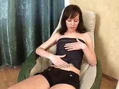 Sensual auburn haired Tona fantasizes about a hard dick while she masturbates her cock-craving pussy at home
