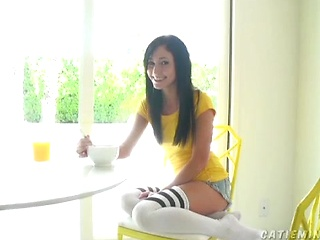It's never too early in the day for Catie to get her first masturbation in. At the breakfast table even! She is one sex crazed minx!