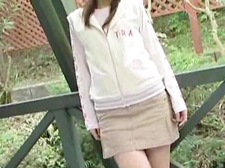 Marika Tachibana takes off her clothes and shows off her shaved pussy and small tits.