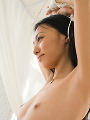 Beautiful asian babe shows her perfect naked petite boobs - Erotic and nude pussy pics at GirlSoftcore.com