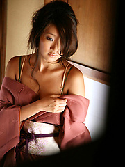 Sexy gravure idol beauty slowly takes off her pink kimono - Erotic and nude pussy pics at GirlSoftcore.com