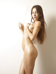 Skinny girl touching her oiled body