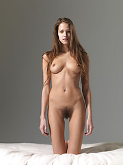 Young model showing her hairy pussy - Erotic and nude pussy pics at GirlSoftcore.com