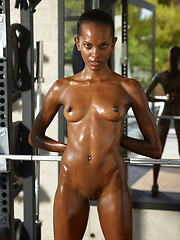 Young oiled black body needs to have a full workout - Erotic and nude pussy pics at GirlSoftcore.com