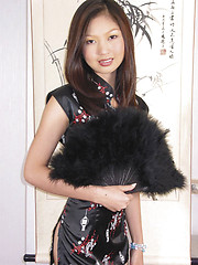 Creamy Thai babe poses in a short silk dress