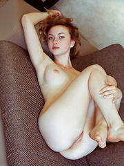 Redhead Jamie Joi strips on the sofa as she flaunts her sweet pussy. - Erotic and nude pussy pics at GirlSoftcore.com