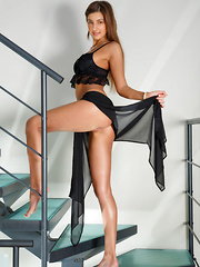 Melena A strips on the stairs as she bares her lusty body. - Erotic and nude pussy pics at GirlSoftcore.com