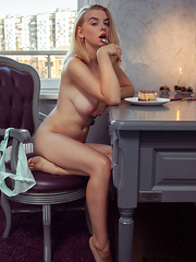 Daniel Sea displays her large tits and meaty ass on the chair. - Erotic and nude pussy pics at GirlSoftcore.com