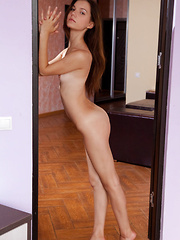 Iva sensually poses on the bed as she bares her petite body. - Erotic and nude pussy pics at GirlSoftcore.com