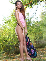 Kenya flaunts her slender, tight body as she poses outdoors. - Erotic and nude pussy pics at GirlSoftcore.com