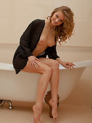 Patritcy A bares her lusty body as she poses by the tub. - Erotic and nude pussy pics at GirlSoftcore.com