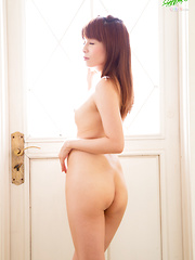 Cute Japanese schoolgirl cosplay turns naughty when Lili-chan decides to get completely naked and show off her nubile body! - Erotic and nude pussy pics at GirlSoftcore.com