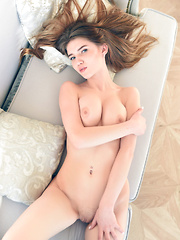 Top model Caramel flaunts her tight body as she strips on the sofa. - Erotic and nude pussy pics at GirlSoftcore.com