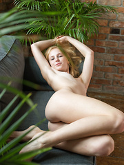 Runa bares her nubile body as she poses on the couch. - Erotic and nude pussy pics at GirlSoftcore.com