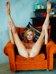 Gerda Rubia flaunts her sexy, tight body and meaty pussy on the chair. - Erotic and nude pussy pics at GirlSoftcore.com