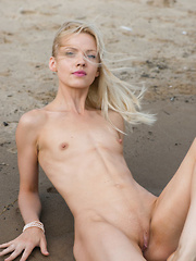 New model Camelia sensually strips at the beach as she bares her petite body. - Erotic and nude pussy pics at GirlSoftcore.com