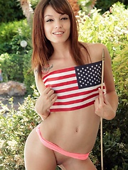 Ashley Doll waves a flag for July 4