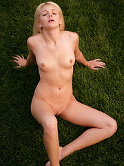 Shy white-haired girl relaxing on the backyard - Erotic and nude pussy pics at GirlSoftcore.com