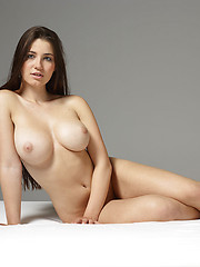 Alone girl showing her perfect round boobs - Erotic and nude pussy pics at GirlSoftcore.com