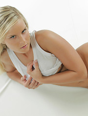 Meet her up close and personal as she strips and shows you everything - Erotic and nude pussy pics at GirlSoftcore.com