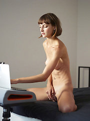 Short-haired skinny girl posing berfore webcam - Erotic and nude pussy pics at GirlSoftcore.com