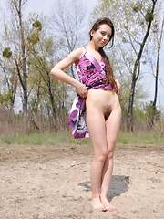 Adorable long haired teen cutie taking off clothes and showing her pretty body outdoors. - Erotic and nude pussy pics at GirlSoftcore.com
