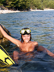 Adorable teen diver in flippers and swim mask showing off incredible nude body on the seaside. - Erotic and nude pussy pics at GirlSoftcore.com