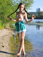 Amazing chick with two long pigtails taking off clothes and spreading legs on the riverside. - Erotic and nude pussy pics at GirlSoftcore.com