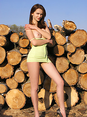 Fascinating busty teen peach undressing and spreading her long slender legs on the logs. - Erotic and nude pussy pics at GirlSoftcore.com
