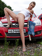 Gorgeous short haired teen beauty stripping and spreading legs outdoor near the red car. - Erotic and nude pussy pics at GirlSoftcore.com