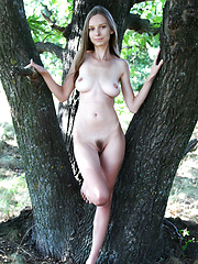 Beautiful long haired girl with impressive breasts demonstrating her sweet pussy outdoor. - Erotic and nude pussy pics at GirlSoftcore.com