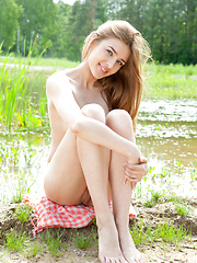 Enchanting teen with attractive body and alluring eyes posing outdoor near a small lake. - Erotic and nude pussy pics at GirlSoftcore.com