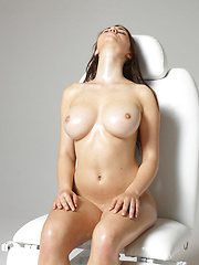 Teen model oiling her body and touching huge boobs - Erotic and nude pussy pics at GirlSoftcore.com