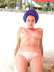 Two nude fashion models posing on the beach - Erotic and nude pussy pics at GirlSoftcore.com
