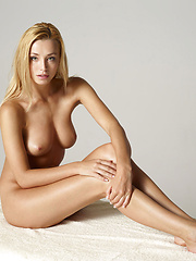 Blonde babe showing her naked breast