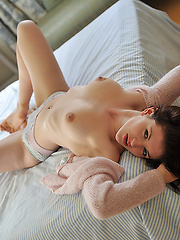 Cute babe doll touching her wet pussy lips - Erotic and nude pussy pics at GirlSoftcore.com