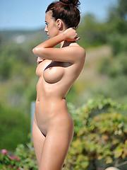 Portugalian girl Tori posing near pool - Erotic and nude pussy pics at GirlSoftcore.com