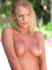 Oiled babe Genesis solo pictures outdoors - Erotic and nude pussy pics at GirlSoftcore.com