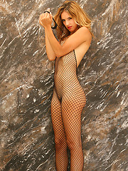 Wearing a full fishnet bodysuit Eva is letting it all hang out - Erotic and nude pussy pics at GirlSoftcore.com