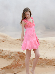 Delicious teen bombshell taking off clothes and showing wonderful naked body in the sands.