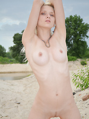 Amazing blonde girl with excellent breasts undressing and showing trimmed pussy outdoors. - Erotic and nude pussy pics at GirlSoftcore.com