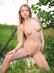 Delightful naked beauty showing off her excellent shapely body outdoor on the riverside. - Erotic and nude pussy pics at GirlSoftcore.com