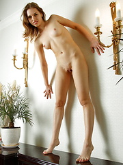 Natalia and her captivating reflection in a vanity mirror makes an erotic twin vision of a smoking hot babe. - Erotic and nude pussy pics at GirlSoftcore.com