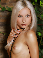 Stunning Adelia shows off her elegant side with a combination of stylized poses and natural allure.
