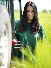 Gwen playfully strips her green shirt matching the green grassy field and poses naughtily all over the jeep, flaunting her awesome physique and gorgeous breasts. - Erotic and nude pussy pics at GirlSoftcore.com