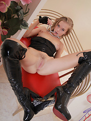 The ever charming yet lusty Milena in a leather seduction, garbed in black corset with leather shorts and strappy stiletto boots. - Erotic and nude pussy pics at GirlSoftcore.com